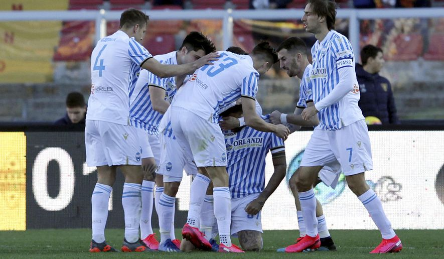 Spal's Andrea Petagna, kneeling, celebrates with teammates after scoring during the Serie A soccer match between Lecce and Spal, at the Via del Mare Stadium in Lecce, Italy, Saturday, Feb. 15, 2020. (Donato Fasano/Lapresse via AP)