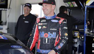 Clint Bowyer gets ready for a NASCAR auto race practice at Daytona International Speedway, Saturday, Feb. 8, 2020, in Daytona Beach, Fla. (AP Photo/Terry Renna)