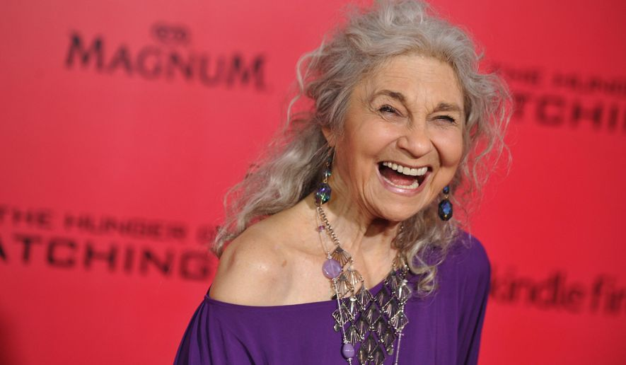 """In this Nov. 18, 2013 file photo, Lynn Cohen arrives at the Los Angeles premiere of """"The Hunger Games: Catching Fire"""" at Nokia Theatre LA Live.  Cohen, an actress best known for playing the plainspoken housekeeper and nanny Magda in """"Sex and the City,"""" has died. She was 86. Cohen died Friday, Feb. 14, 2020, in New York City, said her manager, Josh Pultz. (Photo by Jordan Strauss/Invision/AP)"""
