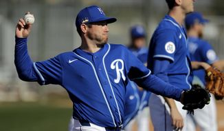 Kansas City Royals pitcher Greg Holland throws during spring training baseball practice Wednesday, Feb. 12, 2020, in Surprise, Ariz. (AP Photo/Charlie Riedel)