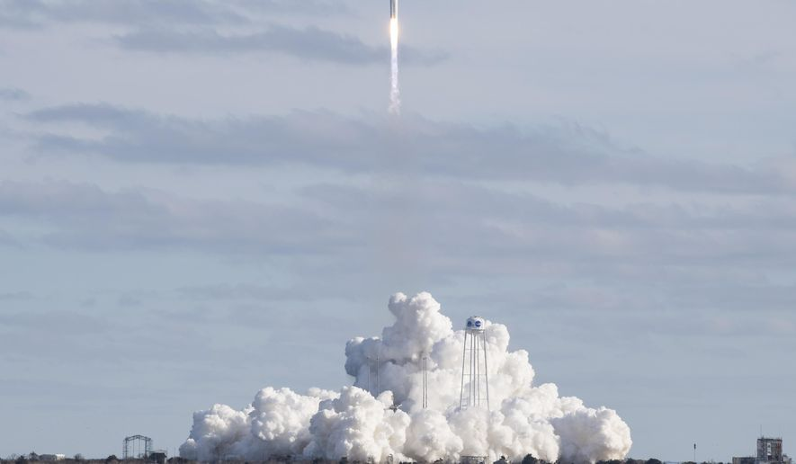 The Northrop Grumman Antares rocket with Cygnus resupply spacecraft onboard, launches at NASA's Wallops Flight Facility on Saturday, Feb. 15, 2020 in Wallops Island, Va. The cargo ship is rocketing toward the International Space Station, carrying the usual experiments and gear but also candy and cheese to satisfy the crew's cravings.  The nearly 4-ton shipment should arrive at the orbiting lab Tuesday. (Aubrey Gemignani/NASA via AP)