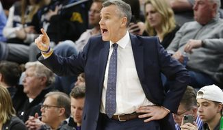 Oklahoma City Thunder's head coach Billy Donovan directs his team against the Minnesota Timberwolves in the second half of an NBA basketball game Monday, Jan. 13, 2020, in Minneapolis. The Thunder won 117-104. (AP Photo/Jim Mone)