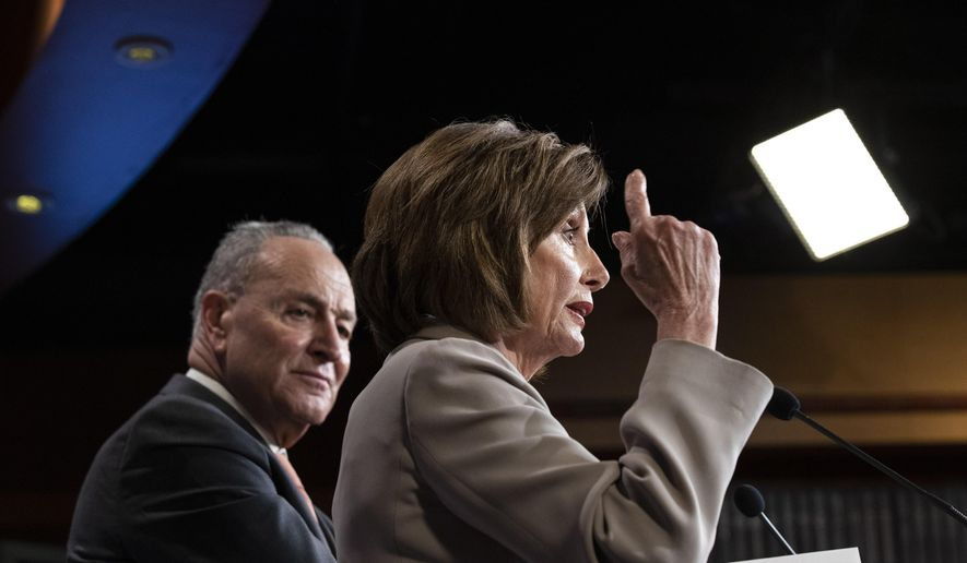 House Speaker Nancy Pelosi of Calif., right, joined by Senate Minority Leader Chuck Schumer of N.Y., speaks during a news conference, on Capitol Hill, Tuesday, Feb.11, 2020, in Washington. (AP Photo/Alex Brandon) **FILE**