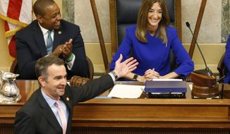 Virginia Gov. Ralph Northam, bottom left, as he recognizes House speaker, Eileen Filler-Corn, D-Farifax, right, while he prepares to deliver his State of the Commonwealth address as Lt. gov. Justin Fairfax, top left, applauds before a joint session of the Virginia Assembly at the Virginia state Capitol in Richmond, Va. (AP Photo/Steve Helber)
