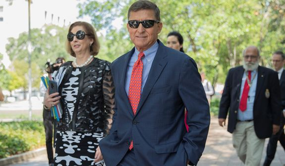 Attorney Sidney Powell (left) asked for an independent review of the prosecution of former National Security Adviser Michael Flynn (center.) Ms. Powell filed a series of arguments accusing the FBI and special counsel team of gross misconduct. (Associated Press)