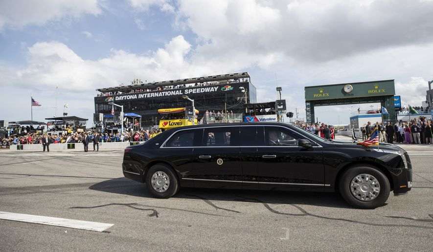 President Donald Trump, accompanied by first lady Melania Trump, drive by before the start of the NASCAR Daytona 500 auto race at Daytona International Speedway, Sunday, Feb. 16, 2020, in Daytona Beach, Fla. (AP Photo/Alex Brandon)