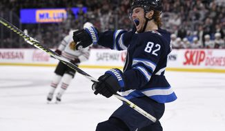Winnipeg Jets' Mason Appleton (82) celebrates his goal against the Chicago Blackhawks during the second period of an NHL hockey game Sunday, Feb. 16, 2020, in Winnipeg, Manitoba. (Fred Greenslade/The Canadian Press via AP)