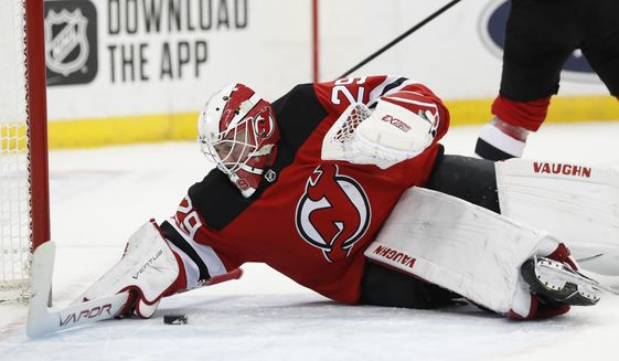 New Jersey Devils goaltender Mackenzie Blackwood (29) makes a save during the first period of an NHL hockey game against the Columbus Blue Jackets, Sunday, Feb. 16, 2020, in Newark, N.J. (AP Photo/Kathy Willens)
