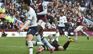 Tottenham's Son Heung-min, left, scores his side's third goal during the English Premier League soccer match between Aston Villa and Tottenham Hotspur at Villa Park in Birmingham, England, Sunday, Feb. 16, 2020. (AP Photo/Rui Vieira)