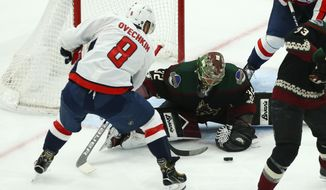 Washington Capitals left wing Alex Ovechkin (8) has his shot stopped by Arizona Coyotes goaltender Antti Raanta (32) during the first period of an NHL hockey game Saturday, Feb. 15, 2020, in Glendale, Ariz. (AP Photo/Ross D. Franklin)