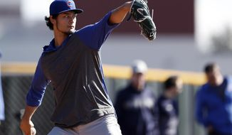 Chicago Cubs pitcher Yu Darvish throws during a spring training baseball workout Wednesday, Feb. 12, 2020, in Mesa, Ariz. (AP Photo/Gregory Bull)