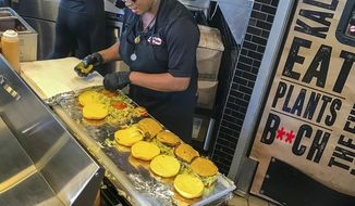 In this Oct. 9, 2019 photo, the staff at the meat-free restaurant Slutty Vegan in Atlanta, treats work like a party. (Todd A. Price/The Daily Advertiser via AP)