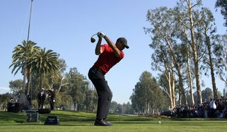 Tiger Woods tees off on the 12th hole during the final round of the Genesis Invitational golf tournament at Riviera Country Club, Sunday, Feb. 16, 2020, in the Pacific Palisades area of Los Angeles. (AP Photo/Ryan Kang) **FILE**