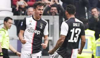Juventus' Paulo Dybala, left, celebrates scoring his side's opening goal during the Serie A soccer match between Juventus and Brescia, a the Allianz Stadium in Turin, Italy, Sunday, Feb. 16, 2020. (Marco Alpozzi/Lapresse via AP)