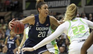 Connecticut's Olivia Nelson-Ododa, left, drives against South Florida's Kristyna Brabencova during the second half of an NCAA college basketball game Sunday, Feb. 16, 2020, in Tampa, Fla. (AP Photo/Mike Carlson)