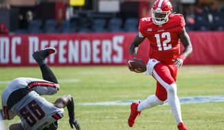 In the XFL's second weekend of action, DC Defenders quarterback Cardale Jones scrambles away from pressure at Audi Field. Jones led the now-2-0 Defenders to a 27-0 rout of the New York Guardians. (All-Pro Reels photo/Brian Murphy) ** FILE **