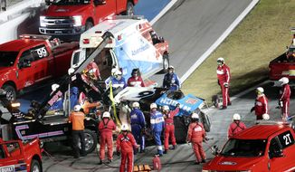 Rescue aid Ryan Newman after he was involved in a wreck on the last lap of the NASCAR Daytona 500 auto race at Daytona International Speedway, Monday, Feb. 17, 2020, in Daytona Beach, Fla. Sunday's race was postponed because of rain. (AP Photo/David Graham)