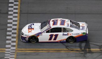 Denny Hamlin (11) gets to the line to win the second stage during the NASCAR Daytona 500 auto race Monday, Feb. 17, 2020, at Daytona International Speedway in Daytona Beach, Fla. Sunday's running of the race was postponed by rain. (AP Photo/Chris O'Meara)