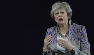 Former British Prime Minister Theresa May speaks at the Global Women's Forum in Dubai, United Arab Emirates, Monday, Feb. 17, 2020. (AP Photo/Kamran Jebreili)