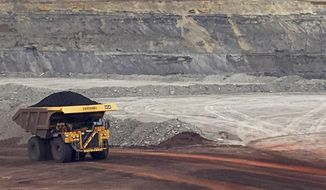 """FILE - In this March 28, 2017 file photo, a dump truck hauls coal at Contura Energy's Eagle Butte Mine near Gillette, Wyo. After the first round of major Powder River Basin coal layoffs and bankruptcies in 2015 and 2016, the buzzworthy response was Wyoming and Campbell County would have to adjust to a """"new normal"""" for the commodity. The times of posting nearly 450 million-ton annual PRB production are long gone, and after a 2019 that was disastrous on many levels for U.S. and Wyoming coal, what's more clear now than ever is that """"new normal"""" isn't a lower baseline for thermal coal, it's an accelerating decline. (AP Photo/Mead Gruver, File)"""