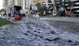 A city of Fort Lauderdale crew responds to a water main break in the area of 100 South Birch Road in Fort Lauderdale Beach. Fort Lauderdale has been dealing with a slew of back-to-back pipe breaks of late. (Susan Stocker/South Florida Sun-Sentinel via AP)