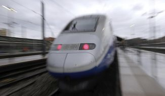 FILE - In this Monday, May 14, 2018 file photo, a TGV high-speed train at the Saint-Charles train station, in Marseille, southern France. French train maker Alstom said Monday Feb. 17, 2020, that it is in talks to possibly take over the train business of Bombardier, the Canadian aerospace and engineering company. (AP Photo/Claude Paris, file)