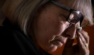 In this picture taken on Friday, Jan. 31, 2020, Yolanda Martinez Garcia cries during an interview with The Associated Press at her home, in Milan. Her son was sexually abused by one of the priests of the Legion of Christ, a disgraced religious order. (AP Photo/Luca Bruno)