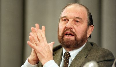 """George Blake, a British defector who spied for the Soviets in Britain, gestures during a news conference in Moscow, Jan. 15, 1992.  Blake said his life's work on behalf of communism had been a failure, but called communism a noble experiment """"and I don't think it was wrong to try,"""" Blake said.  (AP Photo/Boris Yurchenko)"""