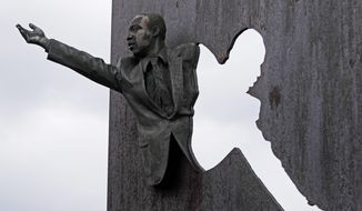 """A sculpture of Martin Luther King Jr. is part of the memorial """"Landmark for Peace"""" commemorating the site where Robert Kennedy delivered his words on the night of King's assassination in Indianapolis, Wednesday, April 4, 2018. The park where Kennedy called for peace and unity just hours after the assassination of King is being designated a National Historic Site. (AP Photo/Michael Conroy)"""