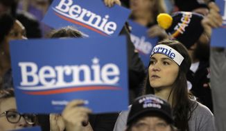 Supporters hold signs during a campaign event for Democratic presidential candidate Sen. Bernie Sanders, I-Vt., in Tacoma, Wash., Monday, Feb. 17, 2020. (AP Photo/Ted S. Warren)