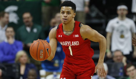 Maryland guard Anthony Cowan Jr. plays against Michigan State in the first half of an NCAA college basketball game in East Lansing, Mich., Saturday, Feb. 15, 2020. (AP Photo/Paul Sancya) ** FILE **