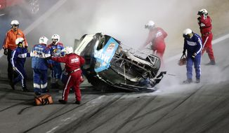 Rescue workers arrive to check on Ryan Newman after he was involved in a wreck on the last lap of the NASCAR Daytona 500 auto race at Daytona International Speedway, Monday, Feb. 17, 2020, in Daytona Beach, Fla. Sunday's race was postponed because of rain. (AP Photo/David Graham) **FILE**