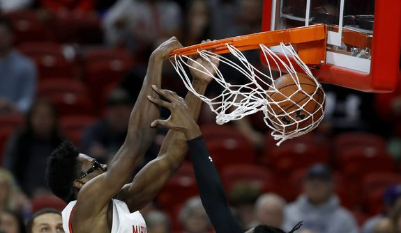 Maryland forward Jalen Smith, left, dunks on Northwestern forward Jared Jones during the first half of an NCAA college basketball game, Tuesday, Feb. 18, 2020, in College Park, Md. (AP Photo/Julio Cortez)