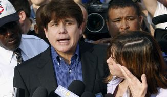 In this March 14, 2012, photo, former Illinois Gov. Rod Blagojevich speaks to the media outside his home in Chicago as his wife, Patti, wipes away tears a day before reporting to prison after his conviction on corruption charges. President Donald Trump is expected to commute the 14-year prison sentence of Blagojevich. The 63-year-old Democrat is expected to walk out of prison later Tuesday, Feb. 18, 2020. (AP Photo/M. Spencer Green) **FILE**