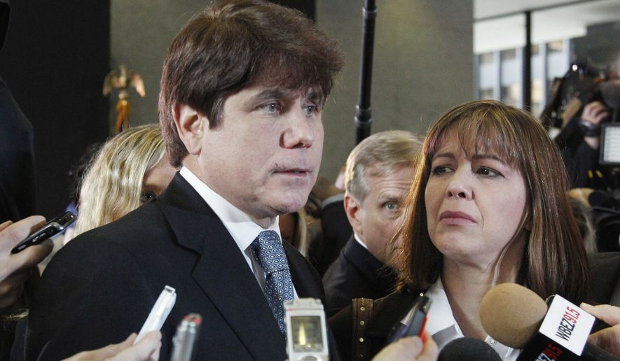 In this Dec. 7, 2011 file photo, former Illinois Gov. Rod Blagojevich, left, speaks to reporters as his wife, Patti, listens at the federal building in Chicago. President Donald Trump on Tuesday, Feb. 18, 2020, has commuted the 14-year prison sentence of former Illinois Gov. Rod Blagojevich. His case had been championed by his wife, Patti, who went on a media blitz in 2018. (AP Photo/M. Spencer Green, File)