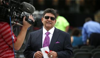 In this Aug. 8, 2015, file photo, former owner of the San Francisco 49ers Edward DeBartolo Jr. is interviewed before the Pro Football Hall of Fame ceremony at Tom Benson Hall of Fame Stadium in Canton, Ohio. President Donald Trump pardoned DeBartolo, who is convicted in a gambling fraud scandal. (AP Photo/Gene J. Puskar, File)