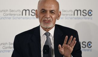 In this Saturday, Feb. 15, 2020 file photo, Afghan President Ashraf Ghani speaks at the Munich Security Conference, in Munich, Germany. The Afghan Independent Election Commission said Tuesday, Feb. 18, 2020, that President Ashraf Ghani has won a second term as president. (AP Photo/Jens Meyer, File)