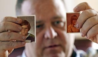 In this Thursday, Feb. 13, 2020, photo, James Kretschmer holds photographs of himself at age 11 and 12 during an interview in Houston. The Boy Scouts of America has filed for bankruptcy protection as it faces a barrage of new sex-abuse lawsuits. The filing Tuesday, Feb. 18, in Wilmington, Del., is an attempt to work out a potentially mammoth compensation plan for abuse victims that will allow the 110-year-old organization to carry on. Kretschmer of Houston, among the many men suing for alleged abuse, says he was molested by a Scout leader over several months in the mid-1970s in the Spokane, Washington, area. (AP Photo/David J. Phillip)