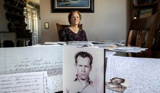 "Janet Uhlar sits for a photo at her dining room table with an arrangement of letters and pictures she received through her correspondence with imprisoned Boston organized crime boss James ""Whitey"" Bulger, Friday, Jan. 31, 2020, in Eastham, Mass. Uhlar was one of 12 jurors who found Bulger guilty in a massive racketeering case, including involvement in 11 murders. But now she says she regrets voting to convict Bulger on the murder charges, because she learned he was an unwitting participant in a secret CIA experiment in which he was dosed with LSD on a regular basis for 15 months. (AP Photo/David Goldman)"