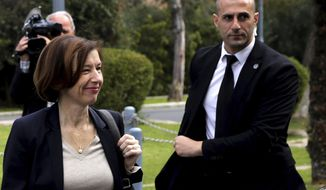 France's Defense Minister Florence Parly, left, arrives at the Presidential Palace for talks with Cypriot President Nicos Anastasiades in capital Nicosia, Cyprus, Tuesday, Feb. 18, 2020. Parly said on Tuesday that her country stands in solidarity with Cyprus amid tensions over a Turkish search for natural gas inside Cypriot waters. (AP Photo/Petros Karadjias)