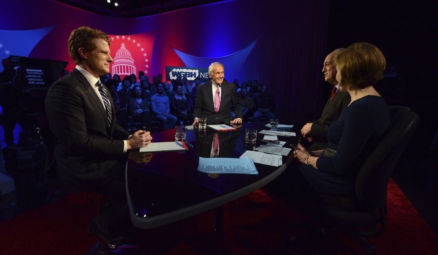 U.S. Rep. Joe Kennedy III, D-Mass, left, and Sen. Ed Markey, second from left, square off in the first senate primary debate hosted by WGBH News on Tuesday, Feb. 18, 2020 at the WGBH Studios in Boston. Moderators Margery Egan, right, and Jim Braude speak with the candidates. (Meredith Nierman/WGBH via AP, Pool)