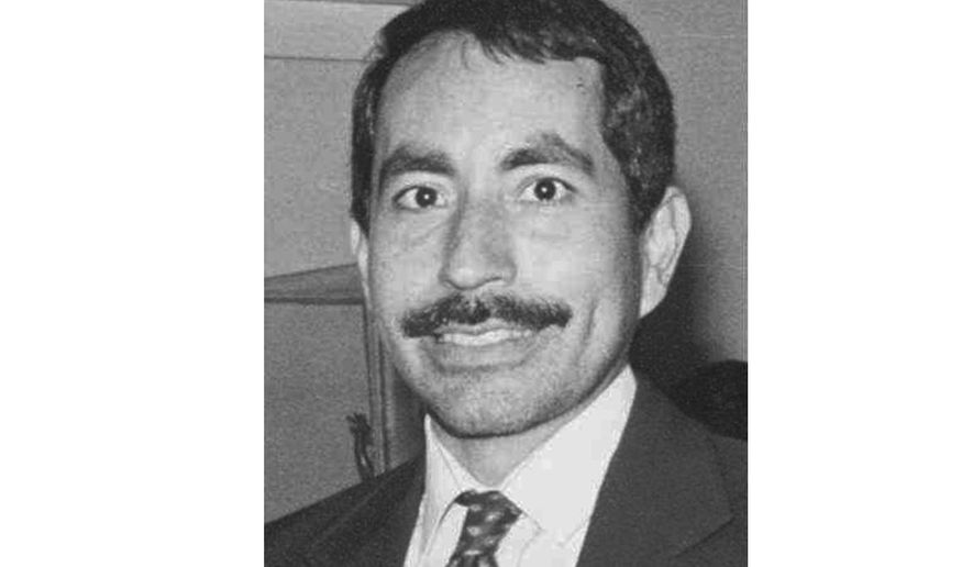 Wyandotte County (Kan.) District Court Judge Carlos Murguia, is seen in an undated black and white photo. Murguia, who was publicly reprimanded last fall after acknowledging that he sexually harassed female employees and had an extramarital affair with an offender, resigned on Tuesday, Feb. 18, 2020. Murguia's resignation is effective April 1, 2020. (AP Photo/The Kansas City Star via AP)