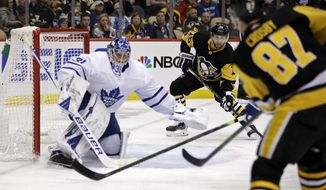 Pittsburgh Penguins' Sidney Crosby (87) passes to Jason Zucker (16) who put a shot behind Toronto Maple Leafs goaltender Frederik Andersen (31) for a goal during the second period of an NHL hockey game in Pittsburgh, Tuesday, Feb. 18, 2020. (AP Photo/Gene J. Puskar)
