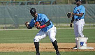 Miami Marlins infielder Jonathan Villar (2) run drills during spring training baseball practice in Jupiter, Fla., Monday, Feb. 17, 2020. (David Santiago/Miami Herald via AP)