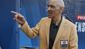 In this Aug. 3, 2019, file photo, former NFL player Tony Dungy is introduced before the induction ceremony at the Pro Football Hall of Fame in Canton, Ohio. Pro football is discovering that the spirit of the Rooney Rule is being violated.  NFL Commissioner Roger Goodell made that a point of emphasis in his state of the league speech during Super Bowl week. So count on Goodell finding ways to more strongly implement the policy that requires teams to interview minority candidates for coaching and executive positions.(AP Photo/Ron Schwane) ** FILE **