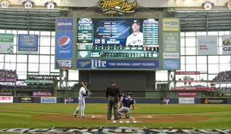 FILE - In this April 6, 2015, file photo, Milwaukee Brewers outfielder Ryan Braun steps into the batters box for his first plate appearance of an Opening Day baseball game against the Colorado Rockies at Miller Park in Milwaukee. The Milwaukee Brewers home ballpark will have a new name next year after a 20-year deal with Miller comes to an end. American Family Insurance announced Tuesday evening, Jan. 21, 2020, that Miller Park will become American Family Field next Jan. 1. A new logo and other branding elements will be revealed later this year. (John Ehlke/West Bend Daily News via AP, File)