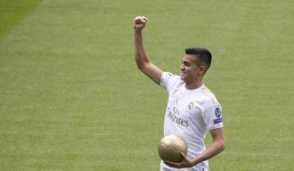 Brazilian player Rainier gestures to fans during his official presentation after signing for Real Madrid at the Santiago Bernabeu stadium in Madrid, Spain, Tuesday, Feb. 18, 2020. (AP Photo/Paul White)