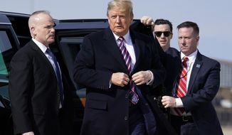 President Donald Trump walks over to talk to the media before he boards Air Force One for a trip to Los Angeles to attend a campaign fundraiser, Tuesday, Feb. 18, 2020, at Andrews Air Force Base, Md. (AP Photo/Evan Vucci)