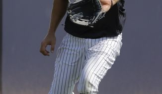New York Yankees' Aaron Judge catches a ball during a spring training baseball workout Tuesday, Feb. 18, 2020, in Tampa, Fla. (AP Photo/Frank Franklin II)