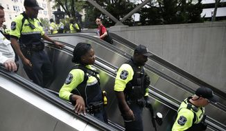 """Metro transit police enter the metro at Foggy Bottom on the one year anniversary of the Charlottesville """"Unite the Right"""" rally, Sunday, Aug. 12, 2018, in Washington. (AP Photo/Jacquelyn Martin) **FILE**"""